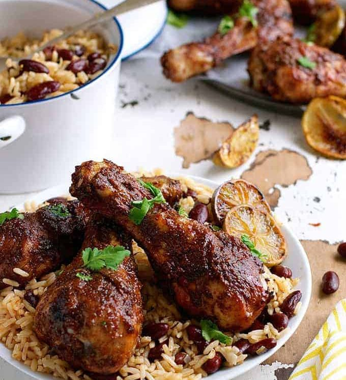 Jamaican Jerk Chicken Drumsticks and Caribbean Rice with Red Beans - the strong, spicy flavours of this chicken is the best from the Caribbean! Easy to make with everyday ingredients.