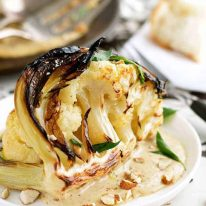 Ester's Roasted Cauliflower with Almond Sauce on white plate