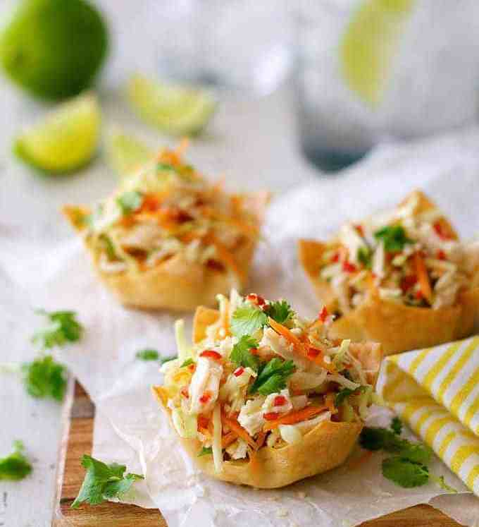 A serving board of Thai Chicken Salad Wonton Cups