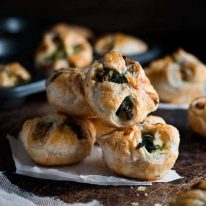 A pile of Ricotta and Spinach Puff Pastry Bites
