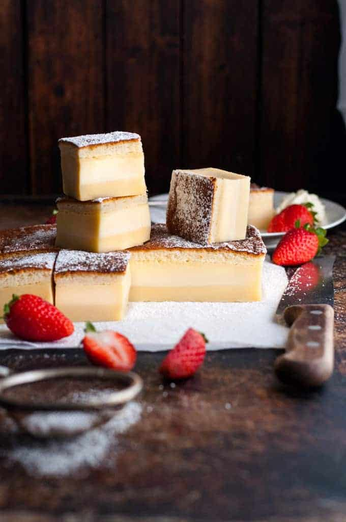 A pile of slices of Magic Three Layer Custard Cake