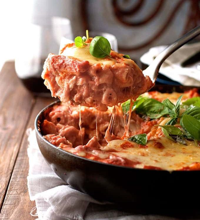 A scoop of Creamy Tomato Pasta Bake With Chicken