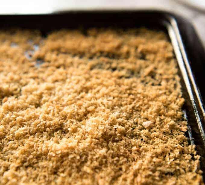Toasted golden panko breadcrumbs on a black tray