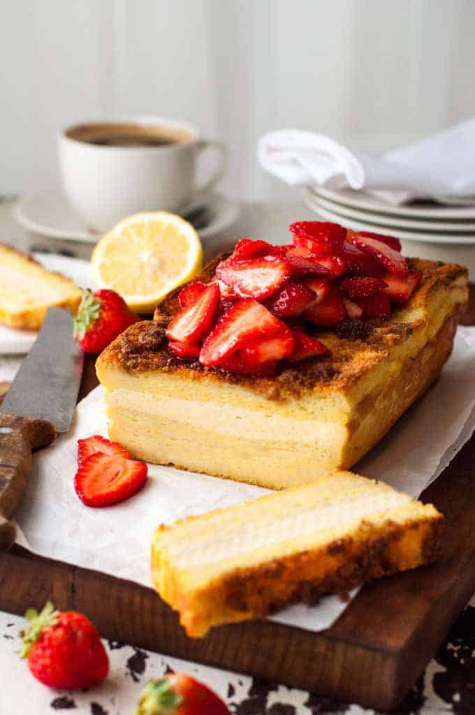 Cream Cheese Stuffed French Toast Loaf topped with strawberries