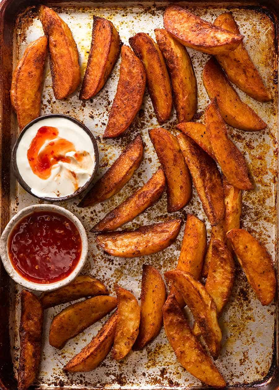 Tray of crunchy seasoned oven baked potato wedges