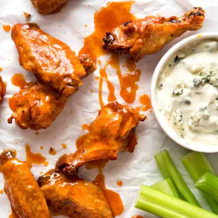 Truly Crispy Oven Baked Buffalo Wings - no false promises here, these wings are seriously crispy and unbelievably easy to make. Tossed in a classic Buffalo Sauce and served with blue cheese sauce. Watch the recipe video to HEAR just how crispy these are! recipetineats.com