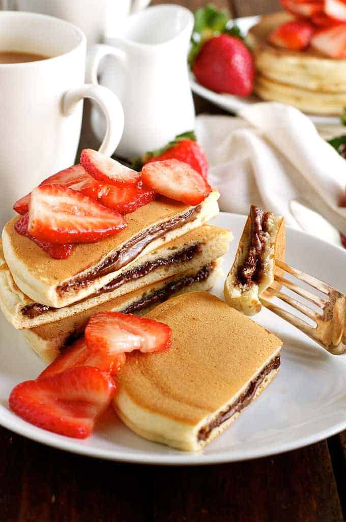 Nutella Pancakes - frozen Nutella discs makes it a breeze to make these Nutella stuffed pancakes! recipetineats.com