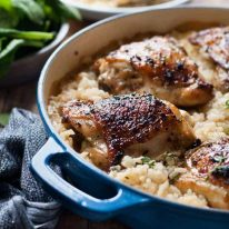 One Pot Creamy Baked Risotto with Lemon Pepper Chicken in a blue pot