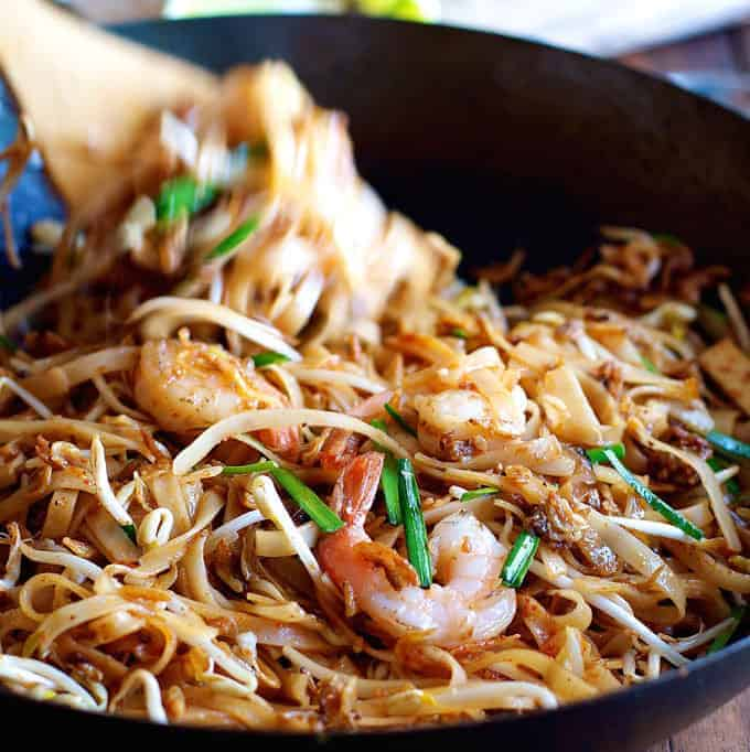Shrimp / Prawn Pad Thai in a black skillet. A restaurant recipe from Spice I Am.