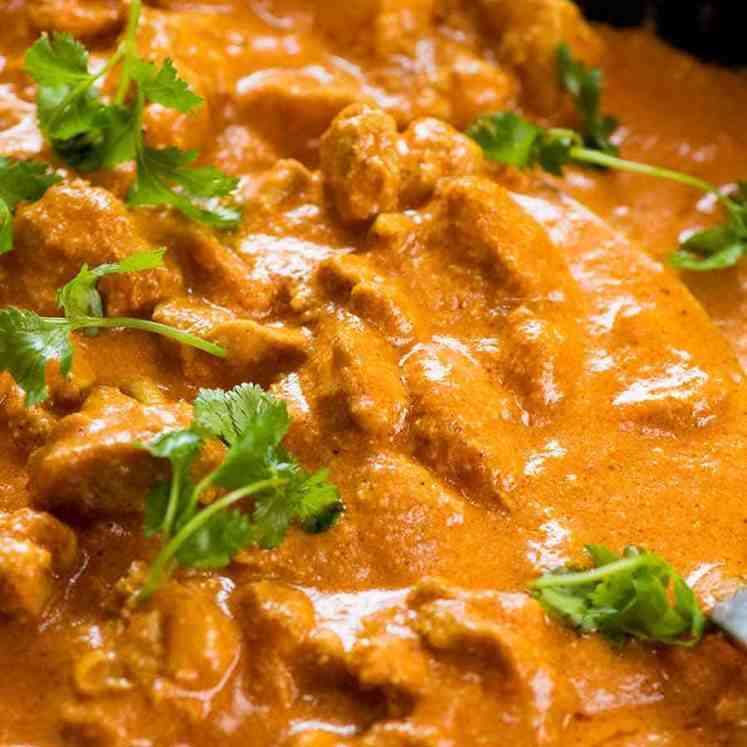 Close up of Butter Chicken in a skillet, fresh off the stove