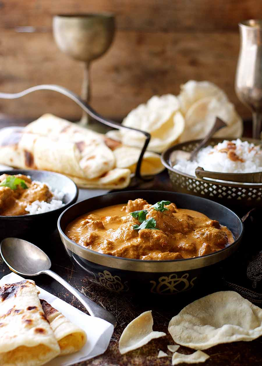 Butter Chicken dinner menu with papadums, naan and basmati rice
