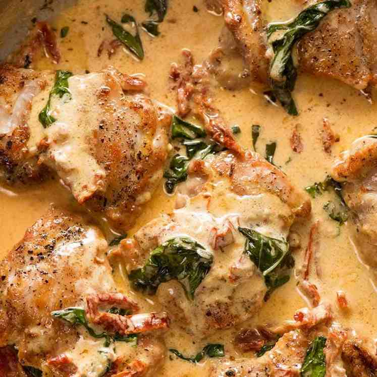 Chicken with Creamy Sun Dried Tomato Sauce in a silver pan, fresh off the stove ready to be served
