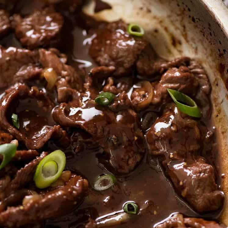 Close up of Chinese Honey Pepper Beef in a skillet, fresh off the stove