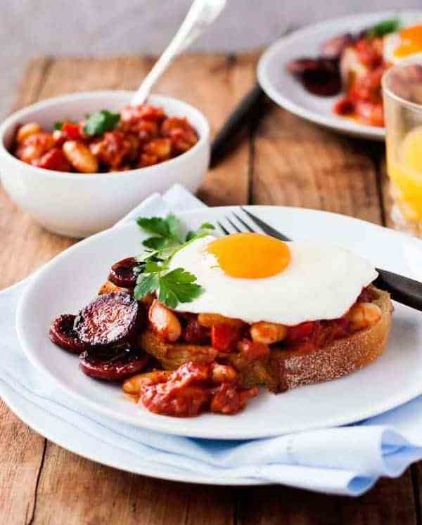 Chorizo Baked Beans on Toast topped with a fried egg