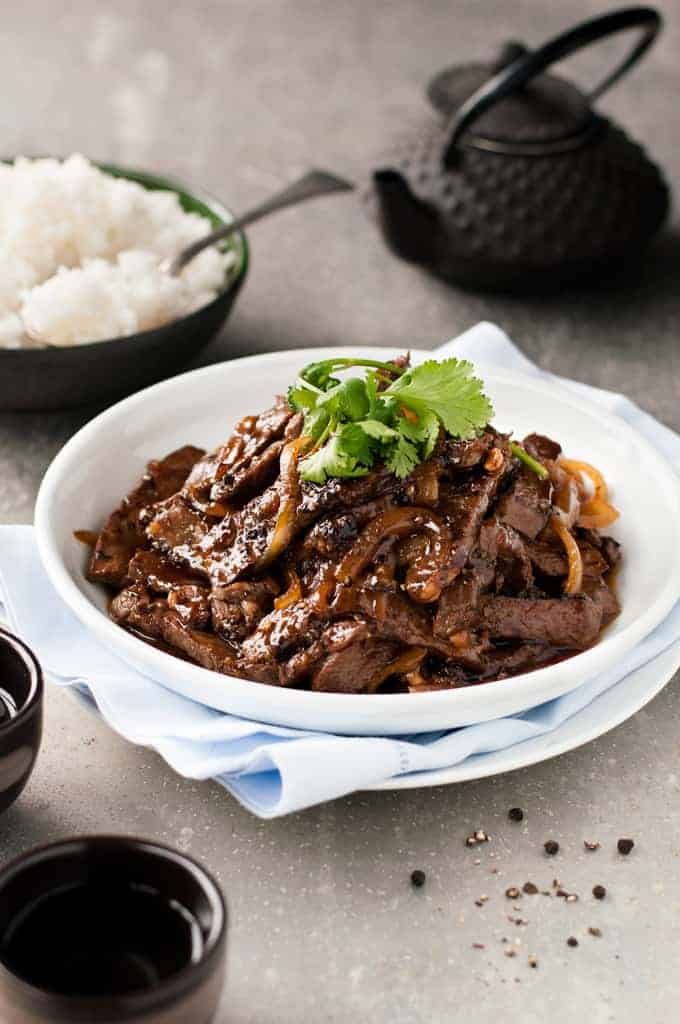 Chinese Beef with Honey Black Pepper Sauce with rice and teapot