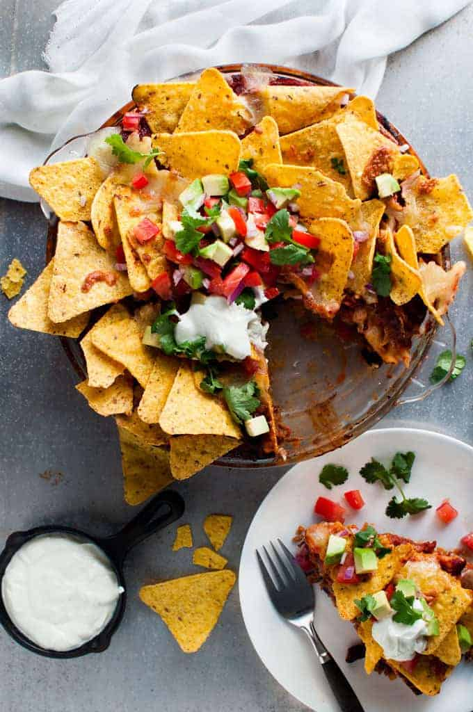 Nachos Pie with tomato and avocado salsa