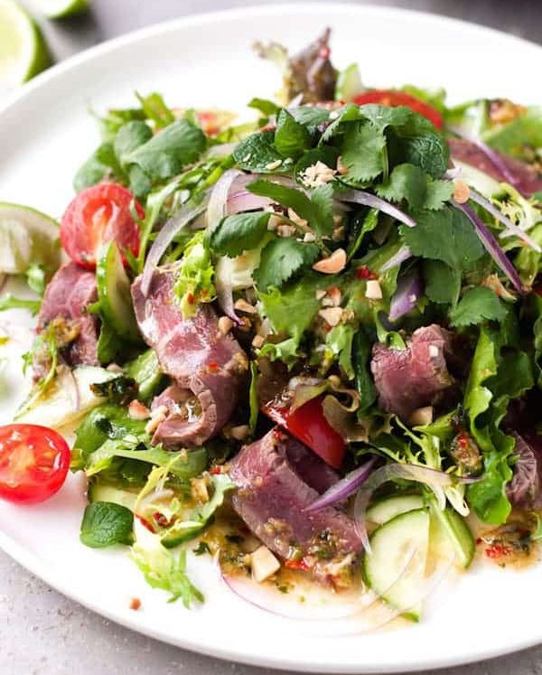 Restaurant-style Thai Beef Salad on white plate