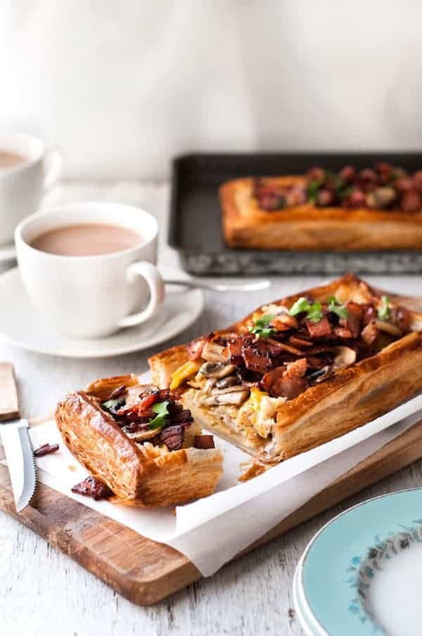 Bacon, Egg and Mushroom Tart on a wooden board, ready to be served.