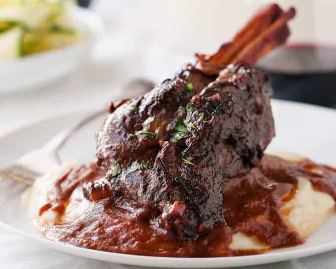 Slow Cooked Lamb Shanks in Red Wine Sauce - a classic recipe, meltingly tender meat and a rich red wine based gravy. Easy to make in the oven, slow cooker or stove! www.recipetineats