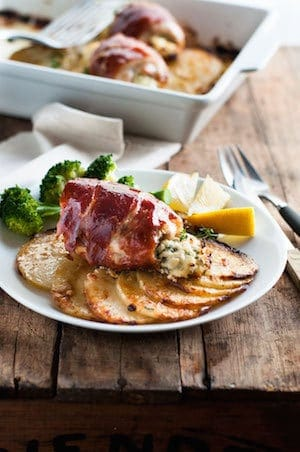 One Pan Prosciutto Wrapped Ricotta Chicken with Scalloped Potatoes - simple to make, elegant enough for company. The chicken adds extra flavor to the golden potatoes!
