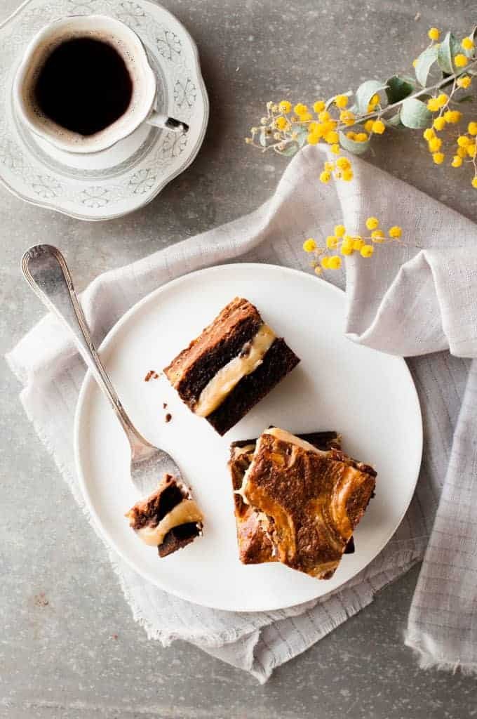Salted Caramel Brownies with cup of coffee