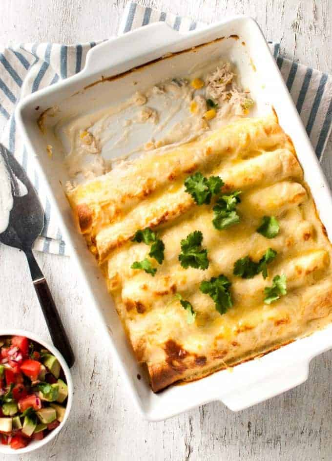 Creamy White Chicken Enchiladas Recipetin Eats