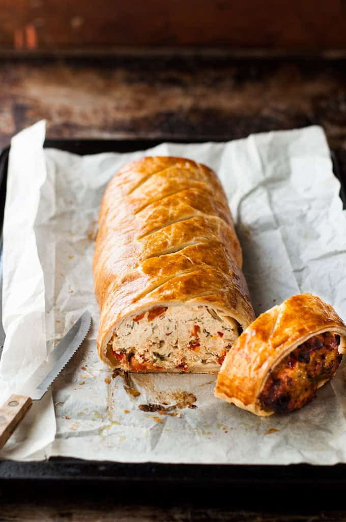 Chicken Meatloaf Wellington sliced, with knife