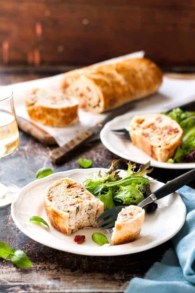 Chicken Meatloaf Wellington sliced and served with salad