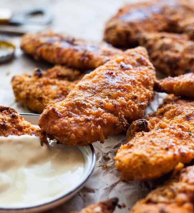 Oven Fried Chicken Tenders - tastes just like KFC, with a crunchy coating, 11 Secret Herbs & Spices and a fraction of the calories! www.recipetineats.com