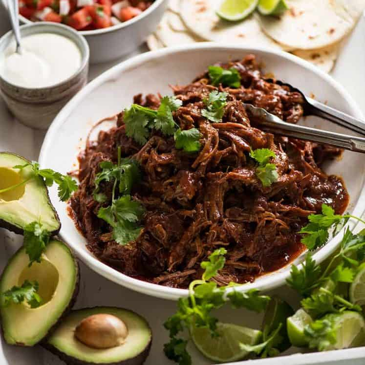 Mexican Shredded Beef taco spread - tortillas, sour cream, avocado, lime, pico de Gallo