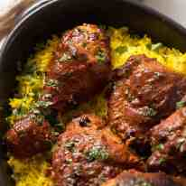 Tandoori Chicken on saffron rice, fresh out of the oven ready to be served