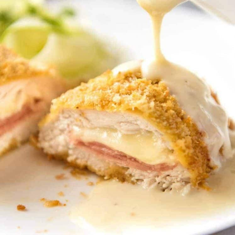 Close up of Dijon Cream Sauce being poured over Easy Chicken Cordon Bleu