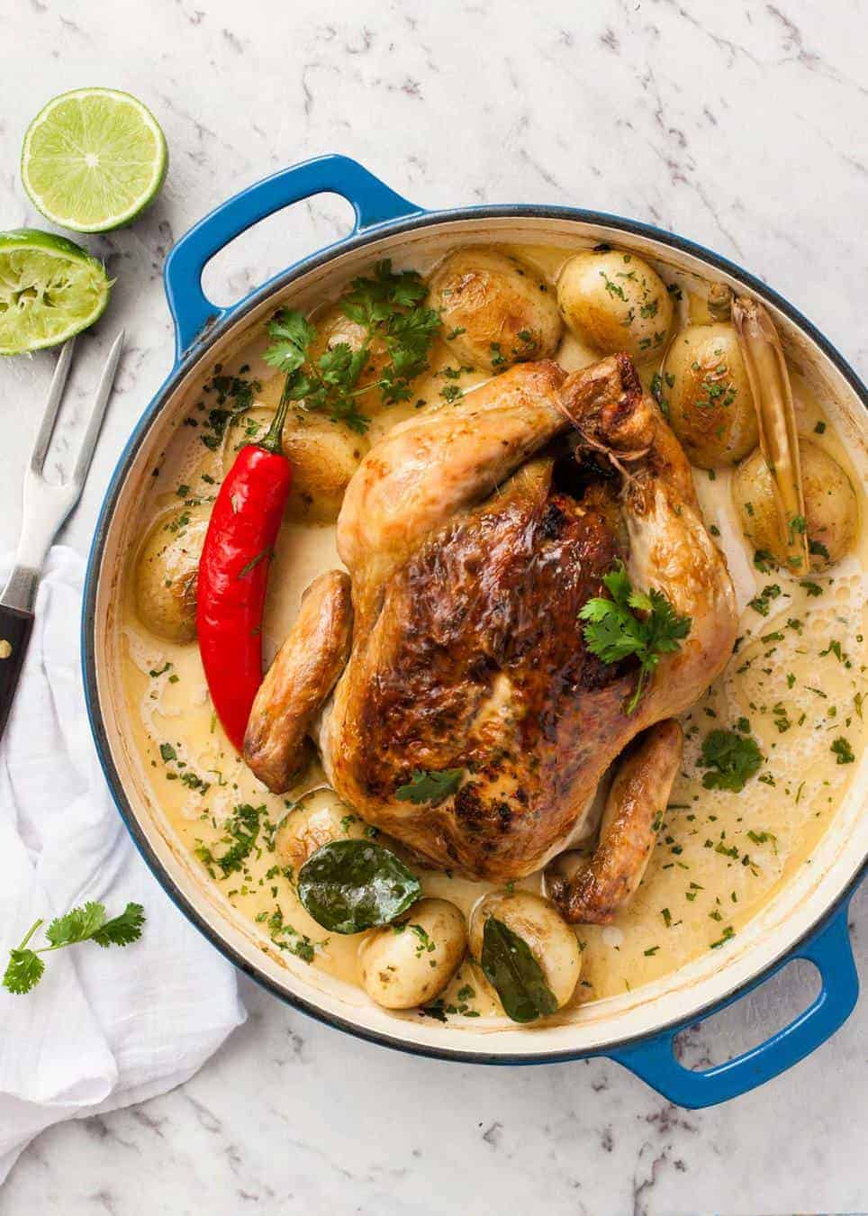 Whole pot roasted chicken in fragrant coconut broth