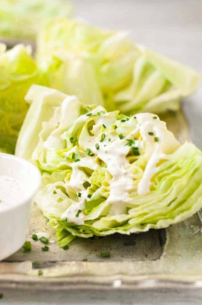 Closeup of Lettuce Wedge Salad with Ranch Dressing