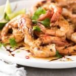 Close up of Asian Grilled Shrimp one a white plate