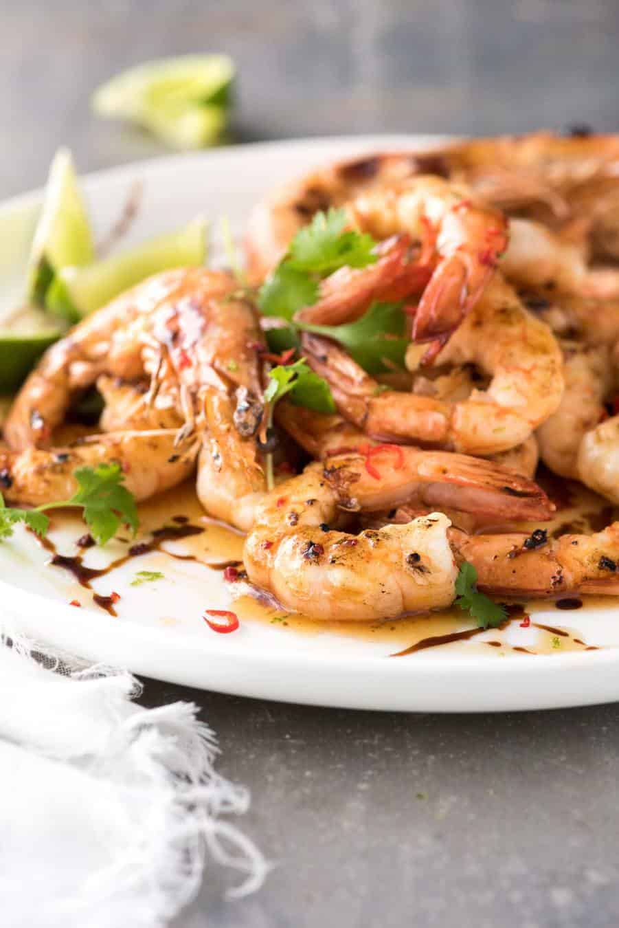 Close up of Asian Grilled Shrimp on a white plate.