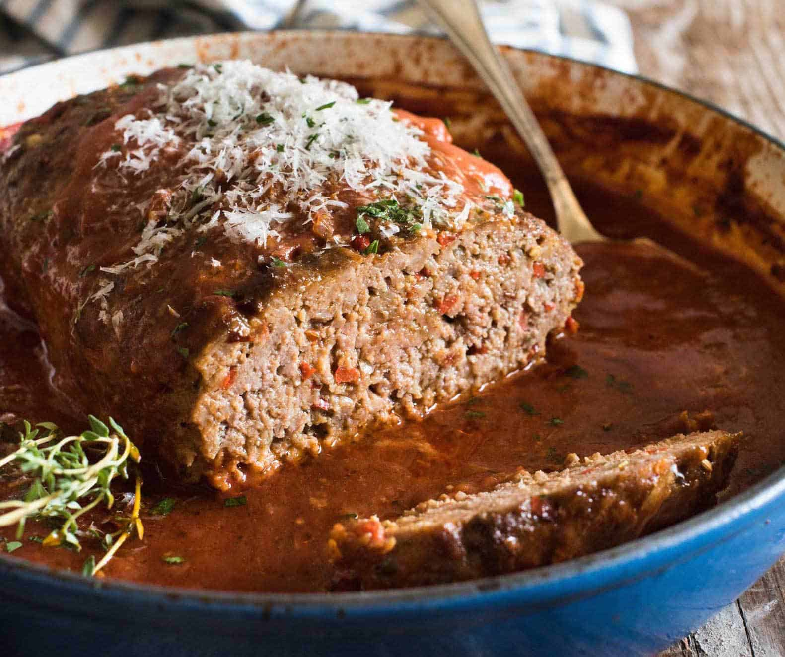 Italian Meatloaf in sauce topped with parmesan cheese
