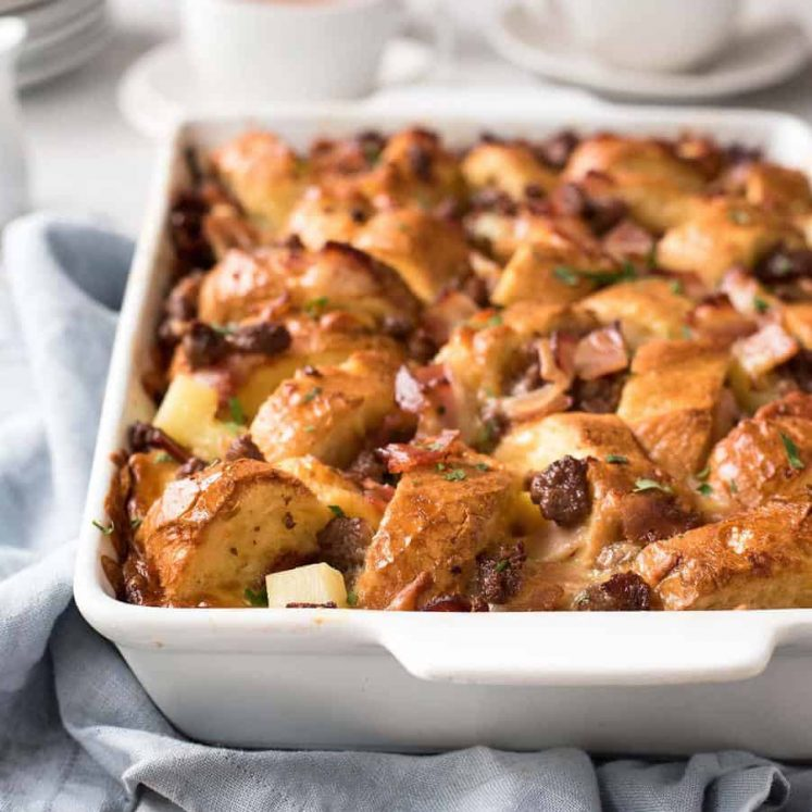 Sausage and Bacon Country Breakfast Casserole in a white dish, ready to be served.