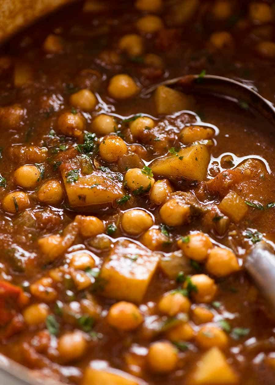 Close up of Chickpea Curry (Chana Aloo) in a pot, ready to be served
