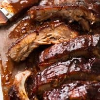 Close up of Barbecue Pork Ribs cooked in Oven with sticky barbecue sauce