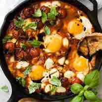 Caprese Baked Eggs drizzled with balsamic vinegar, with toast