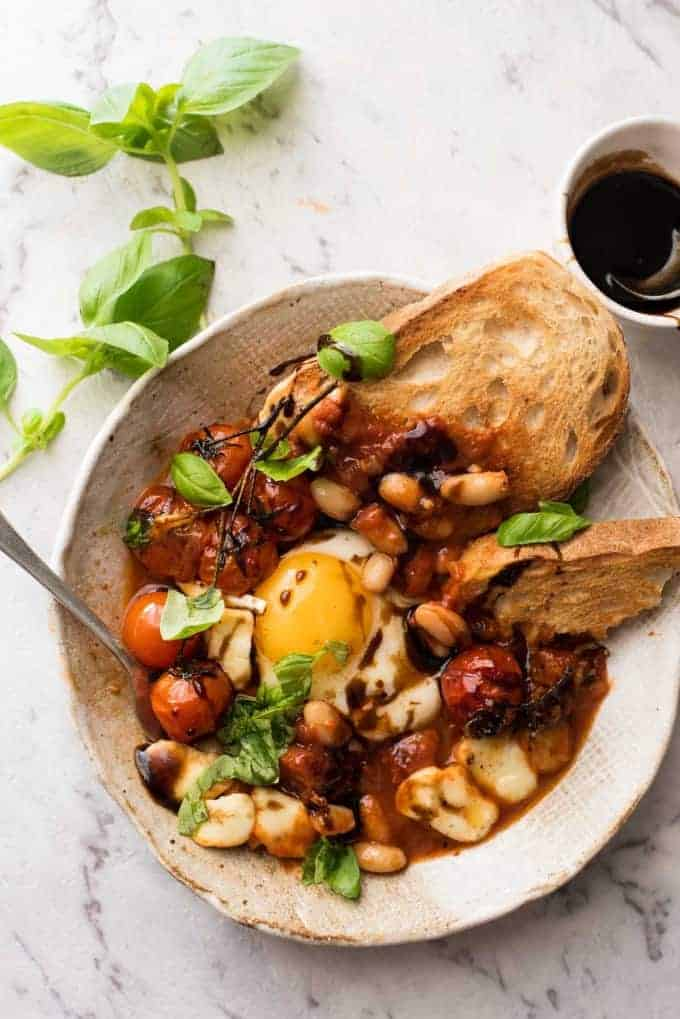 Caprese Baked Eggs with toast and balsamic