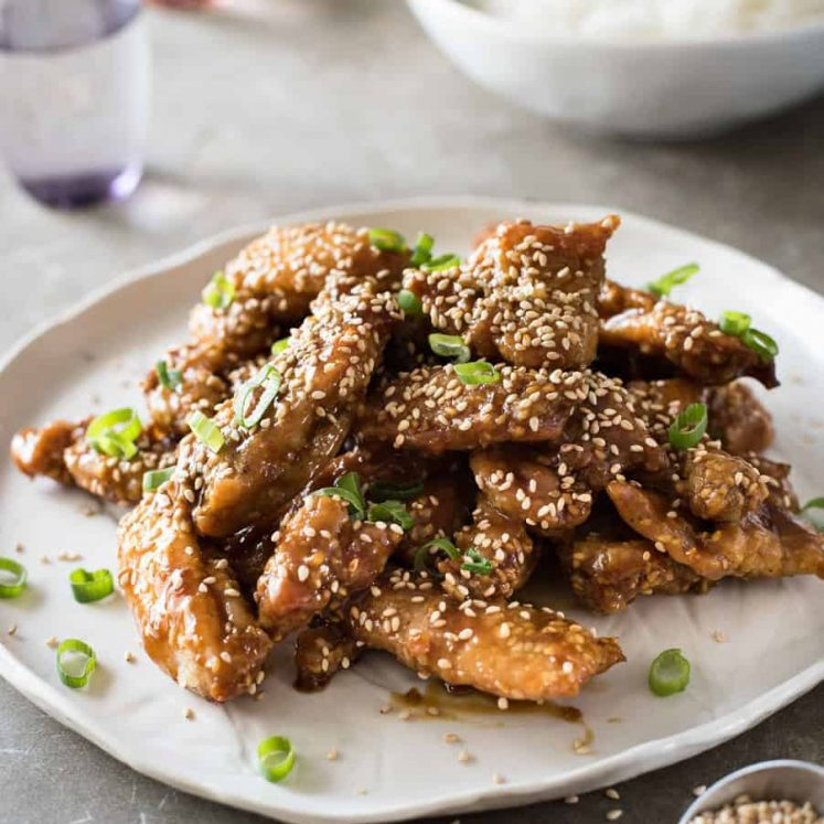 Easy Chinese Honey Sesame Chicken - BAKED, not deep fried, this chicken is coated in a gorgeous sticky irresistible sauce!