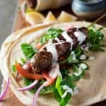 Turkish Lamb Kebab Kofta on pita with vegetables and yoghurt sauce