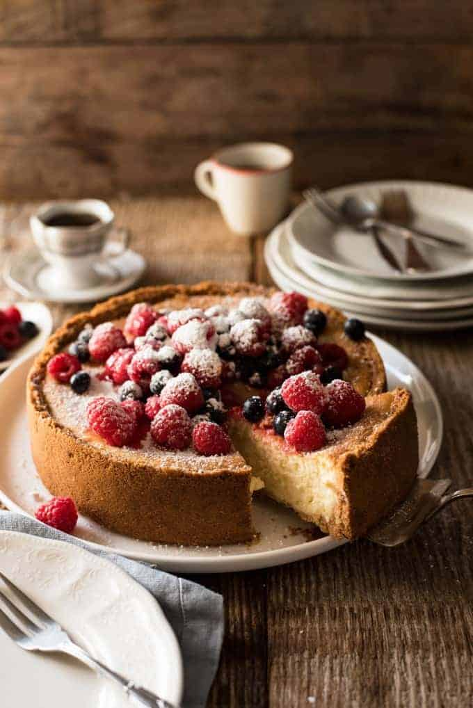 Easy Classic Baked Cheesecake - Creamy and rich, yet light, with a couple of secret tips, this is surprisingly easy to make!