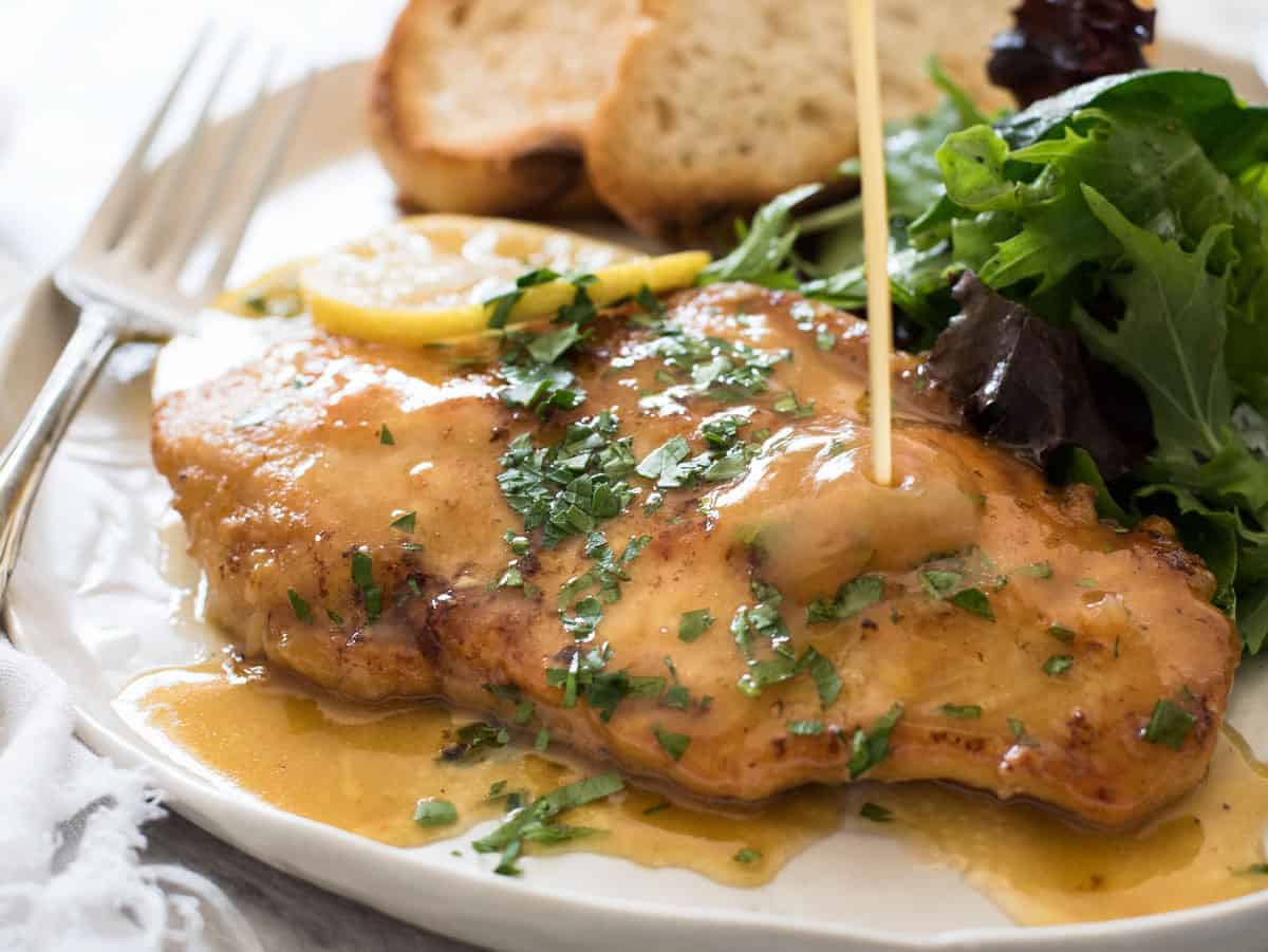 Honey Lemon Chicken - Golden brown chicken breast with a gorgeous honey lemon sauce. On the table in 15 minutes! www.recipetineats.com