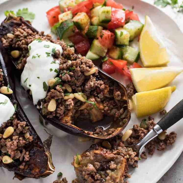 Moroccan Baked Eggplant with Beef with yoghurt topping and cucumber tomato salad