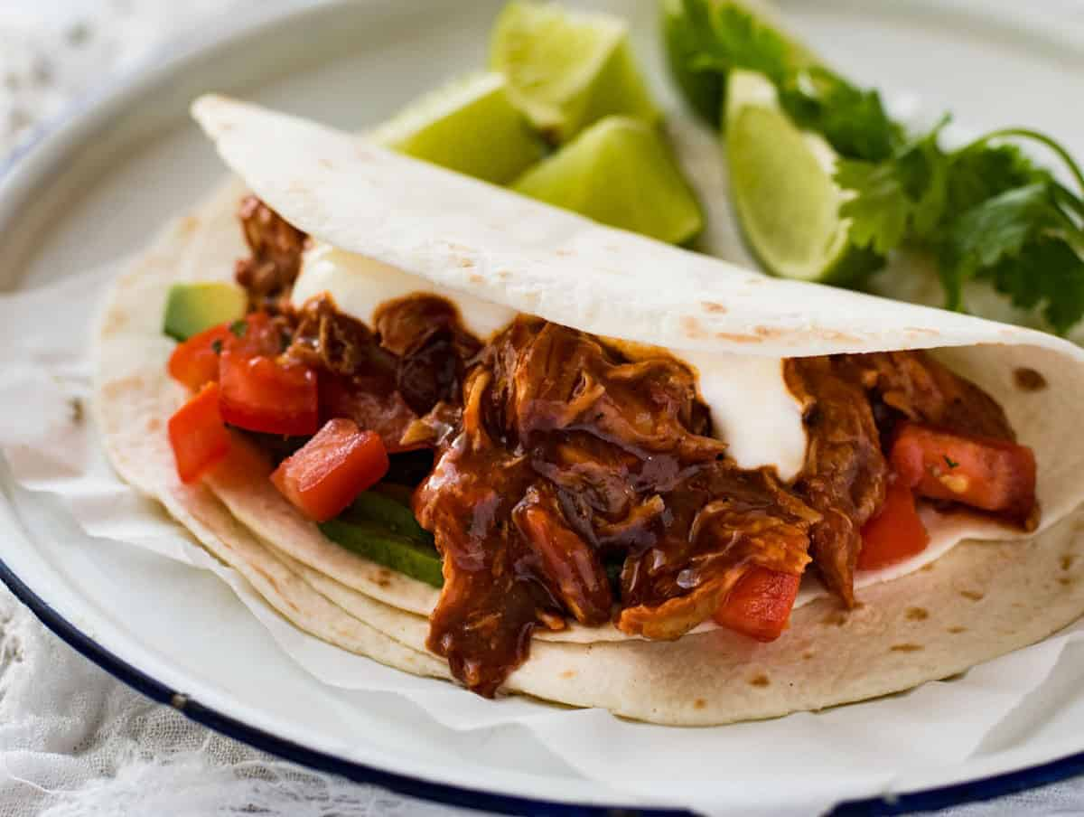 Stupid easy slow cooker Mexican shredded chicken tacos. A true dump and cook crockpot recipe that results in the most flavorful, juicy Mexican pulled chicken.. Shawn and I are extremely even tempered. In the 12 years we have been together (yes, 12 years, we started dating at 15 and 16!), we have never had a 5/5(1).
