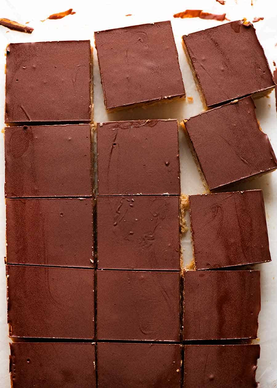 Overhead photo of Caramel Slice cut into pieces showing the chocolate didn't crack