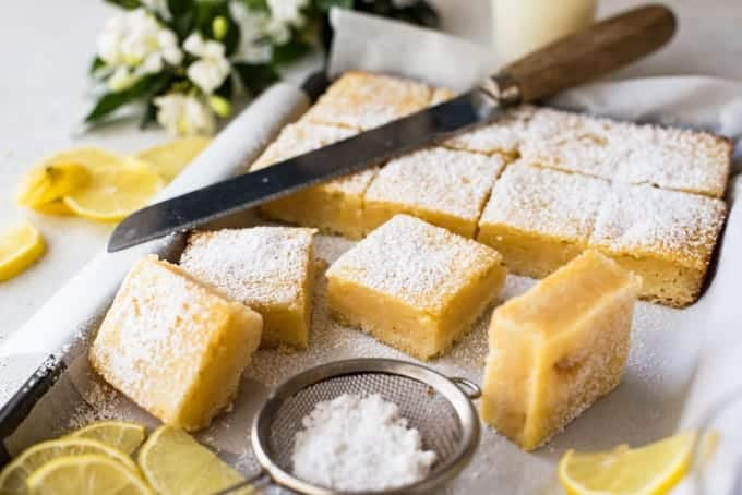Slices of A stack of Easy Lemon Bars in a tray